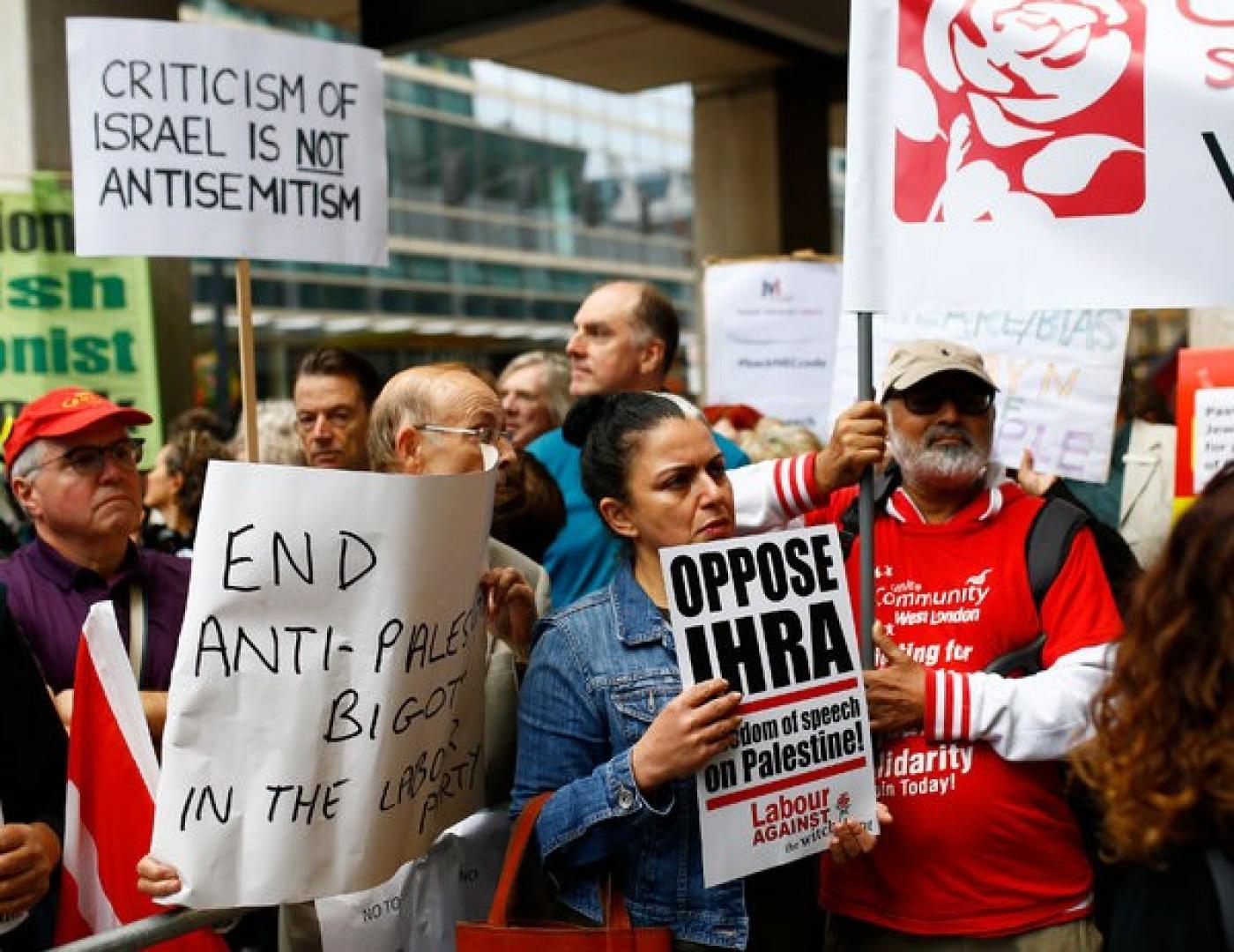 Labour Party supporters protest against the expulsion of party members accused of anti-Semitism outside the party's National Executive Committee meeting in London (Reuters)