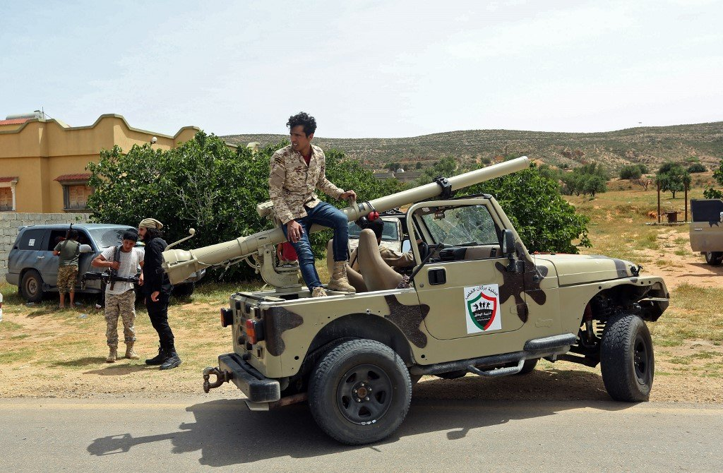 Fighters loyal to Libya's GNA gather east of Tripoli on 19 April (AFP)