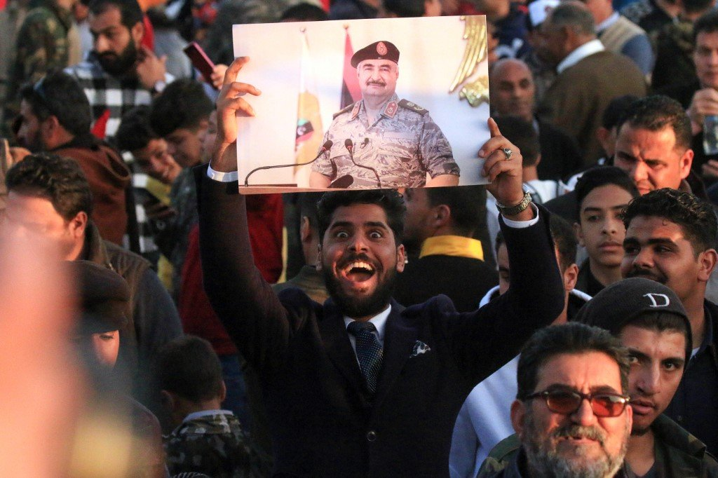 Supporters of Libyan military strongman Khalifa Haftar protest against Turkish intervention in the country's affairs in Benghazi on 14 February (AFP)