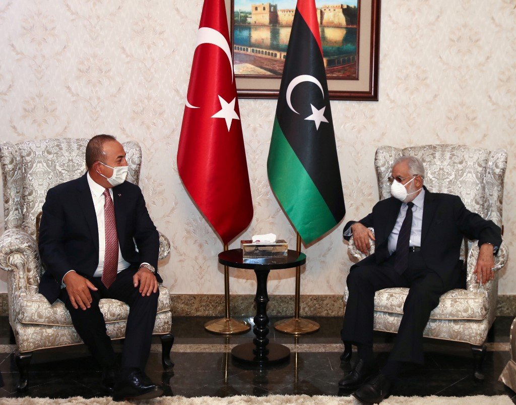 Turkish Foreign Minister Mevlut Cavusoglu meets Libyan Foreign Minister Mohamed Taha Siala in Tripoli on 17 June (Turkish Foreign Ministry/AFP)