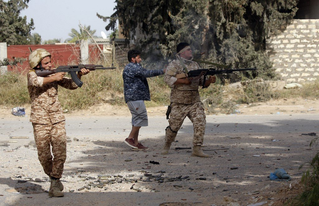 Libyan fighters loyal to the GNA fire during clashes with forces loyal to Khalifa Haftar south of the Tripoli suburb of Ain Zara on 20 April (AFP)