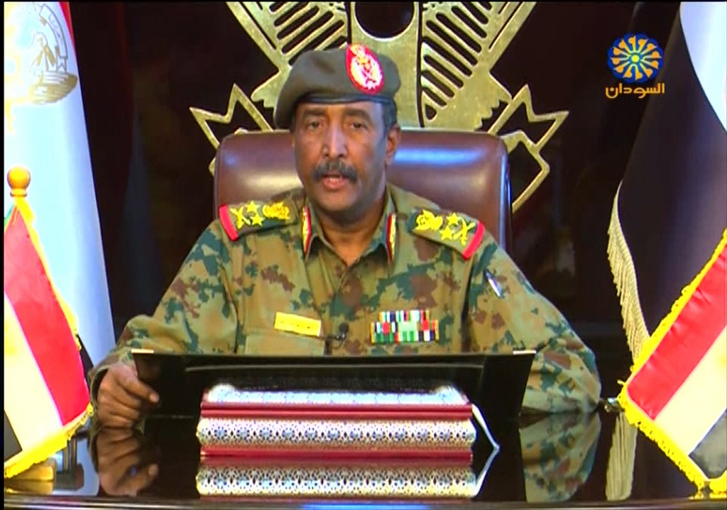 Lieutenant General Abdel Fattah al-Burhan speaks in Khartoum on 13 April (Sudan TV/Handout/AFP)