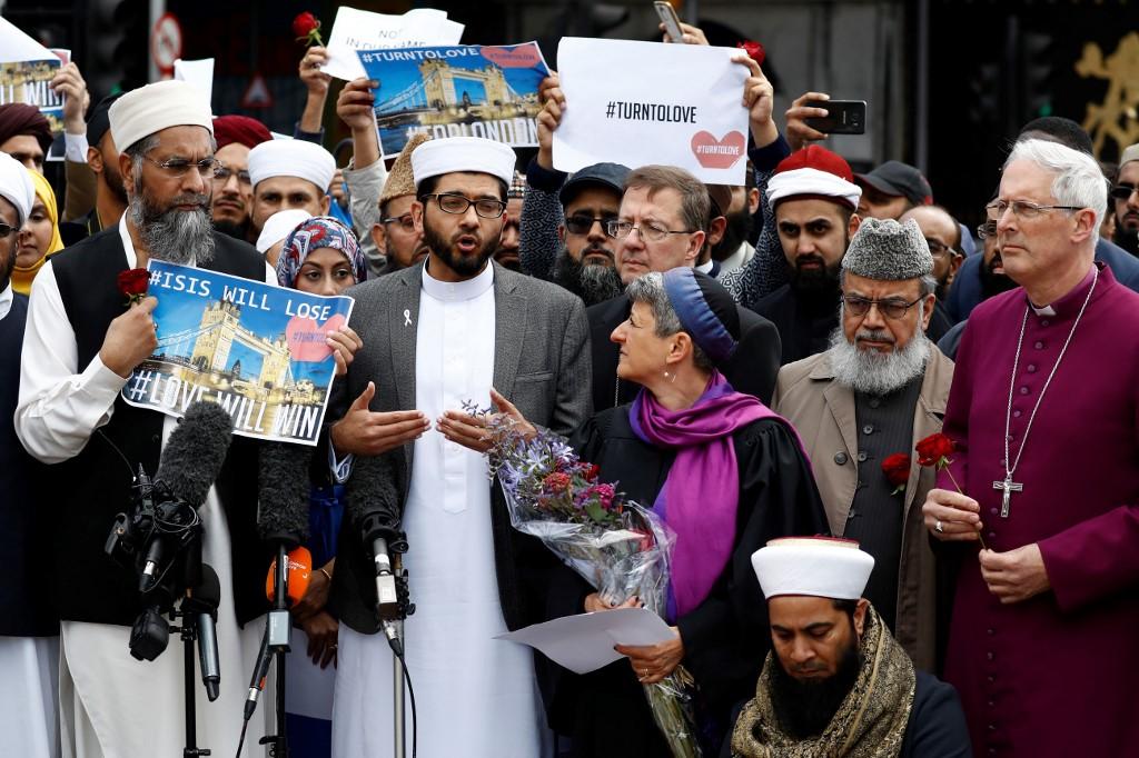 Religious leaders gather near London Bridge on 7 June, 2017 (AFP)