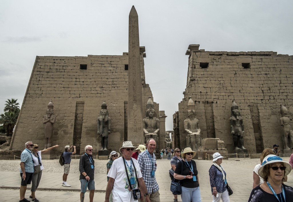 Tourists visit the Luxor Temple in Egypt's southern city of Luxor, on March 11, 2020. Egyptian authorities said that 46 French and US tourists