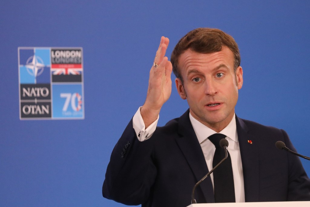 French President Emmanuel Macron speaks at the NATO summit near London on 4 December (AFP)