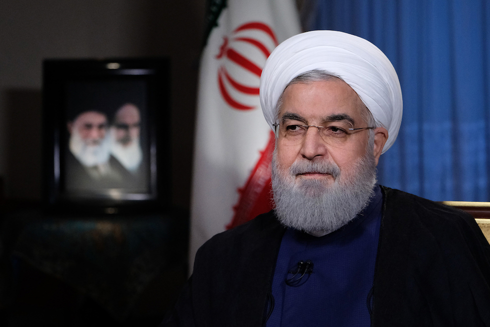 Under fire, Iran's Rouhani calls for unity
