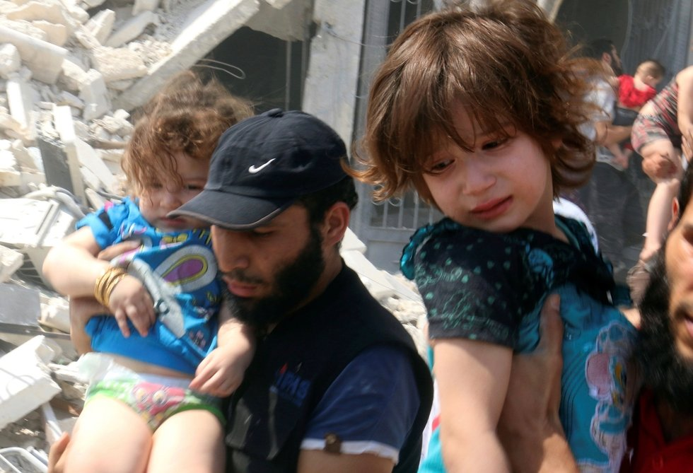 Barrel bomb 'double tap' kills at least 15 funeral mourners in Syria's Aleppo