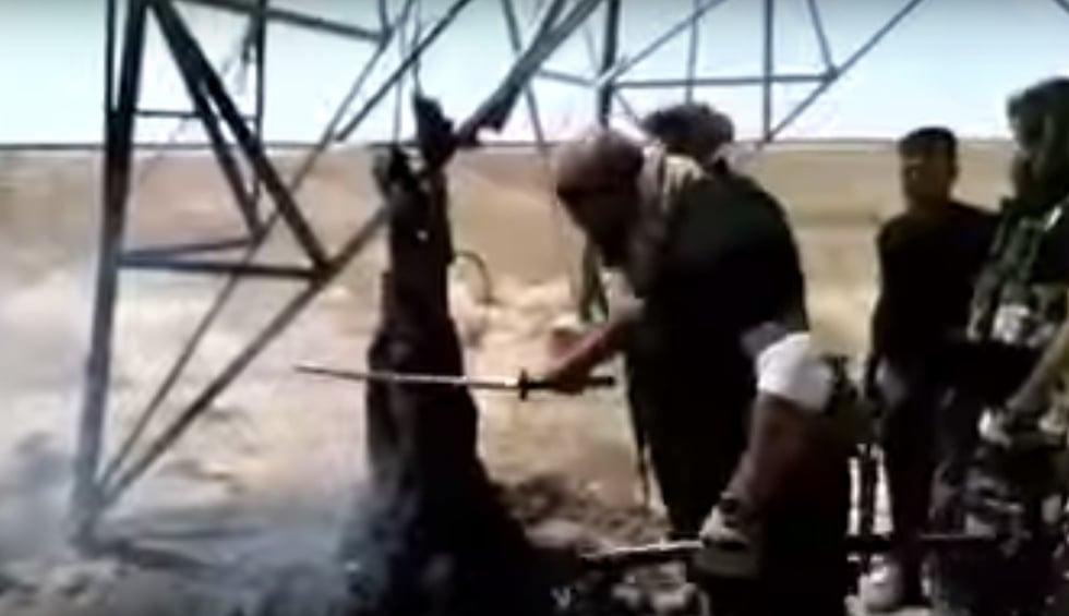 video  iraq shia militiaman cuts burnt corpse  u0026 39 like