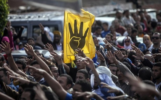 Egypt sentences Muslim Brotherhood chief and 65 others to life in prison