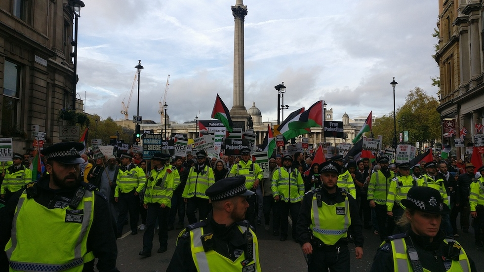 Pro-Palestine demonstrators march down a street in central London in 2017 (MEE/Areeb Ullah)