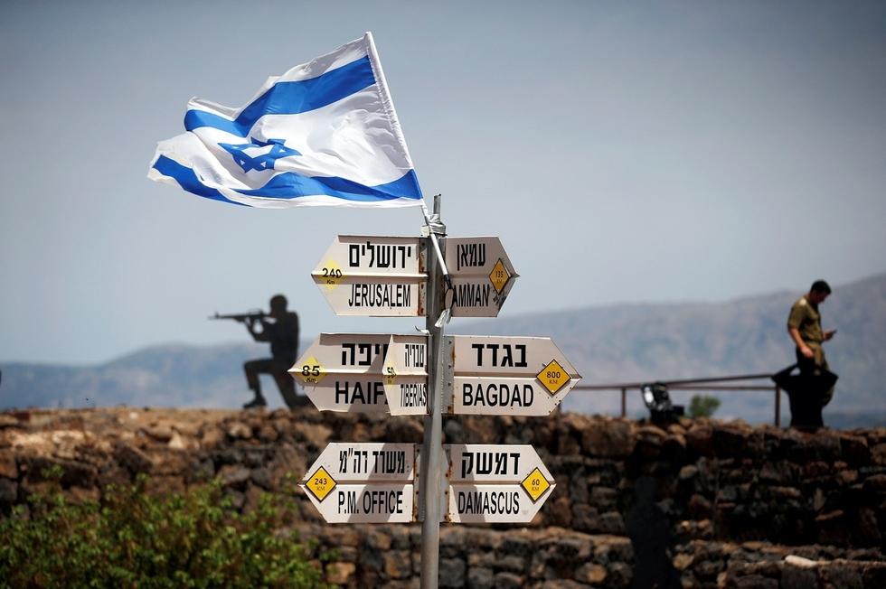 Israel softens tone on Assad but threatens Syrian troops near Golan