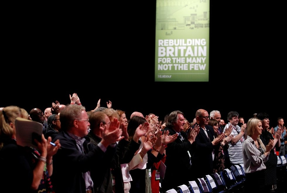 Delegates applaud at the Labour Party's conference in Liverpool (Reuters)