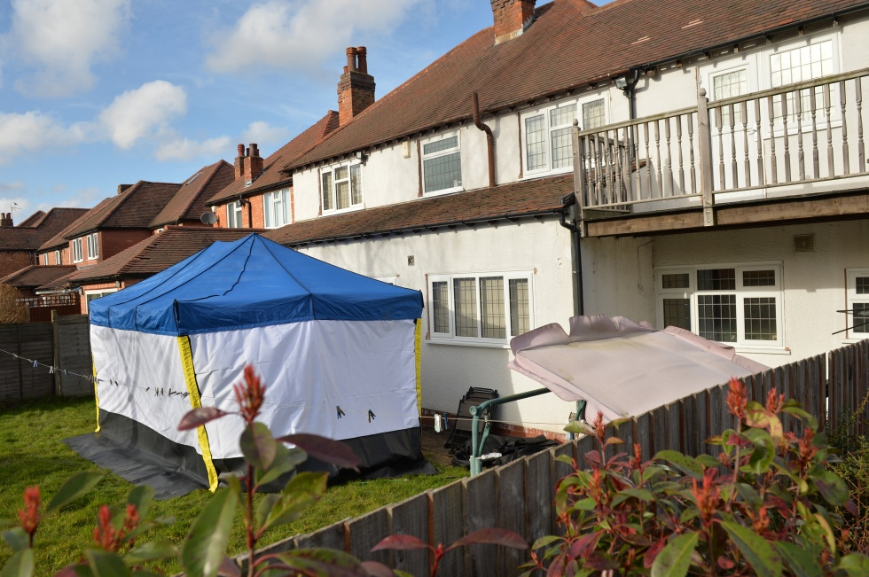 A police forensic tent is seen in the garden of a house in Birmingham, central England on 25 February, 2014 where former Guantanamo Bay detainee Moazzam Begg was arrested (AFP)