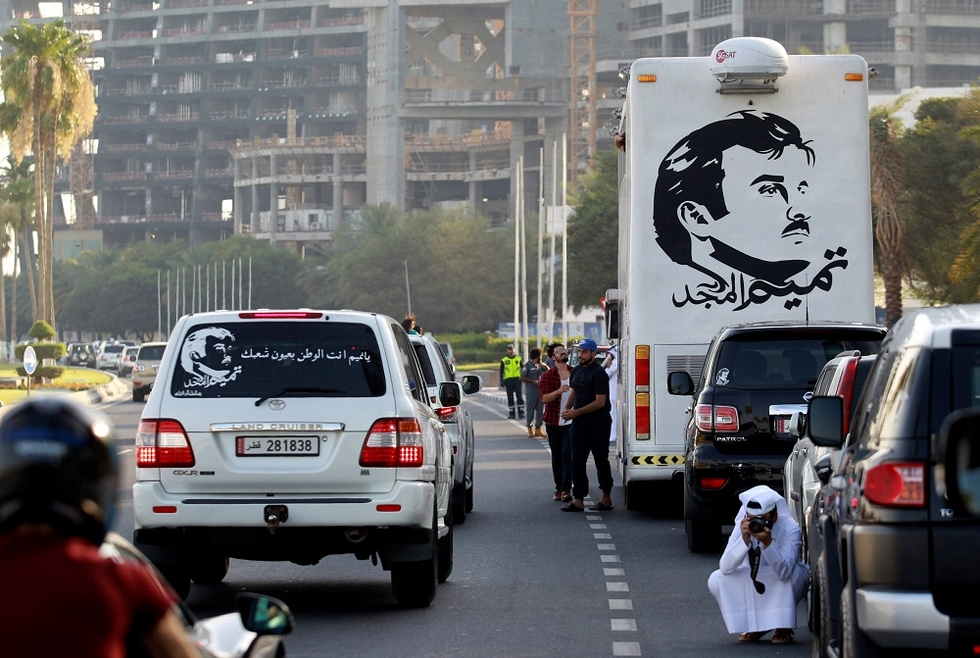 Painting depicting Qatar's Emir Tamim Bin Hamad al-Thani splashed on bus in Doha (Reuters)