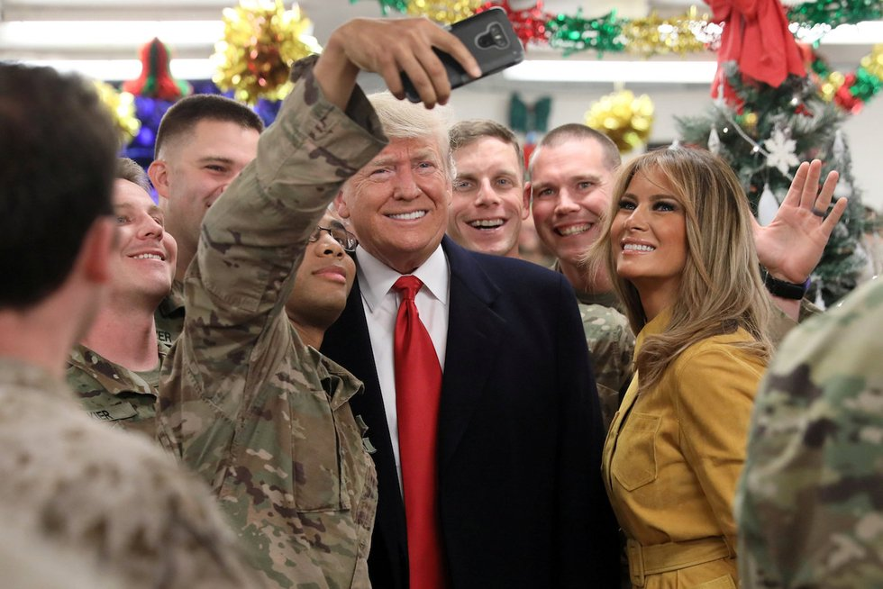 Trump defends Syria withdrawal during surprise visit to US base in Iraq