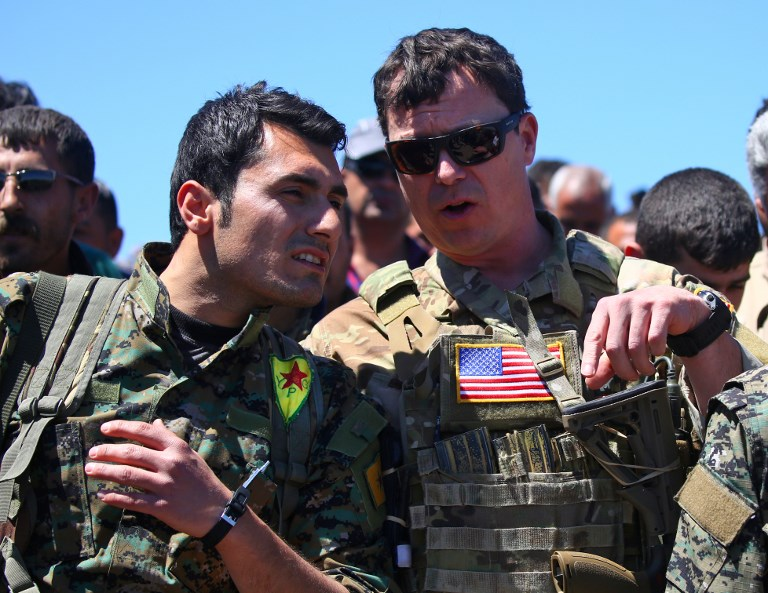 Turkey says Syrian Kurdish fighters will be 'buried in ditches'