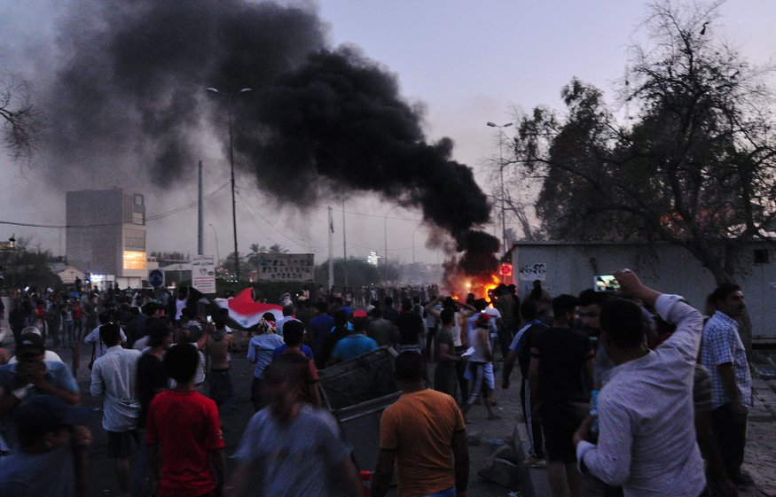 Police use tear gas against protesters threatening to shut down production at Basra oilfield