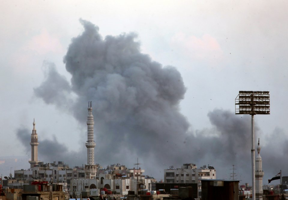 Syrian government jets pound militants in Damascus suburb