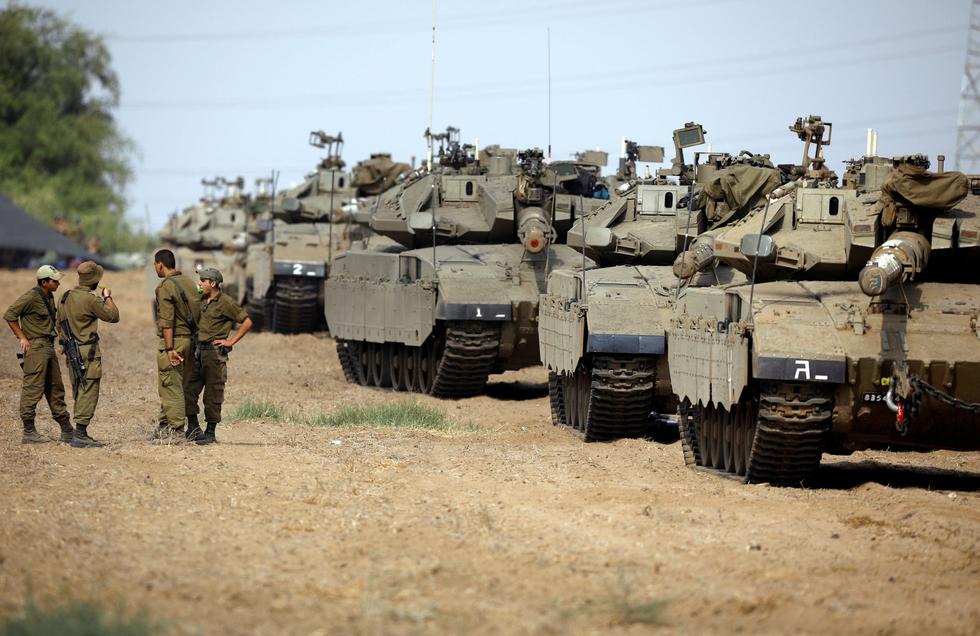 Dozens of Israeli tanks mass around Gaza ahead of Friday protests