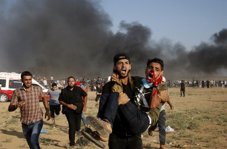 Israeli forces kill one Palestinian, injure hundreds in Gaza