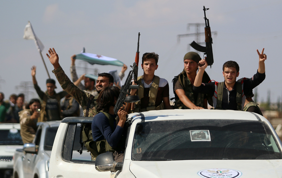 First rebel group begins withdrawal from demilitarised zone in Syria's Idlib