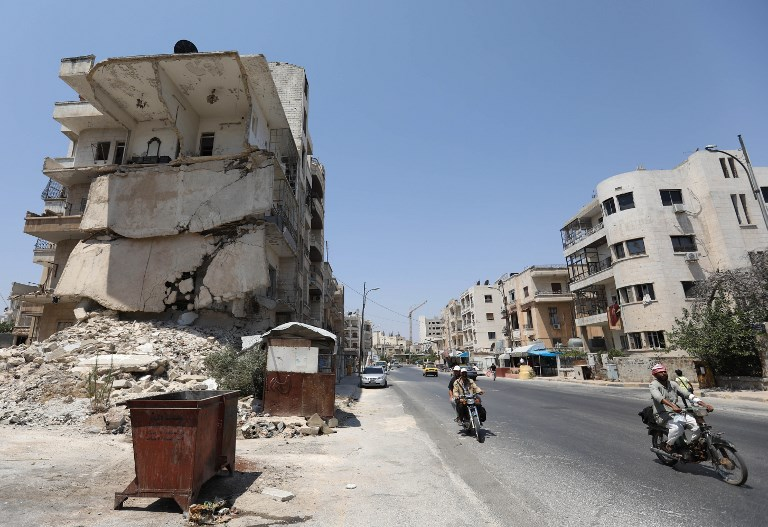 Syria rebels say they arrest dozens over collusion with government