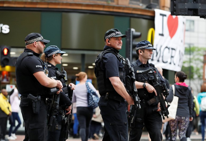 Armed police officers stand on duty in central Manchester, Britain in May, 2017 (Reuters)