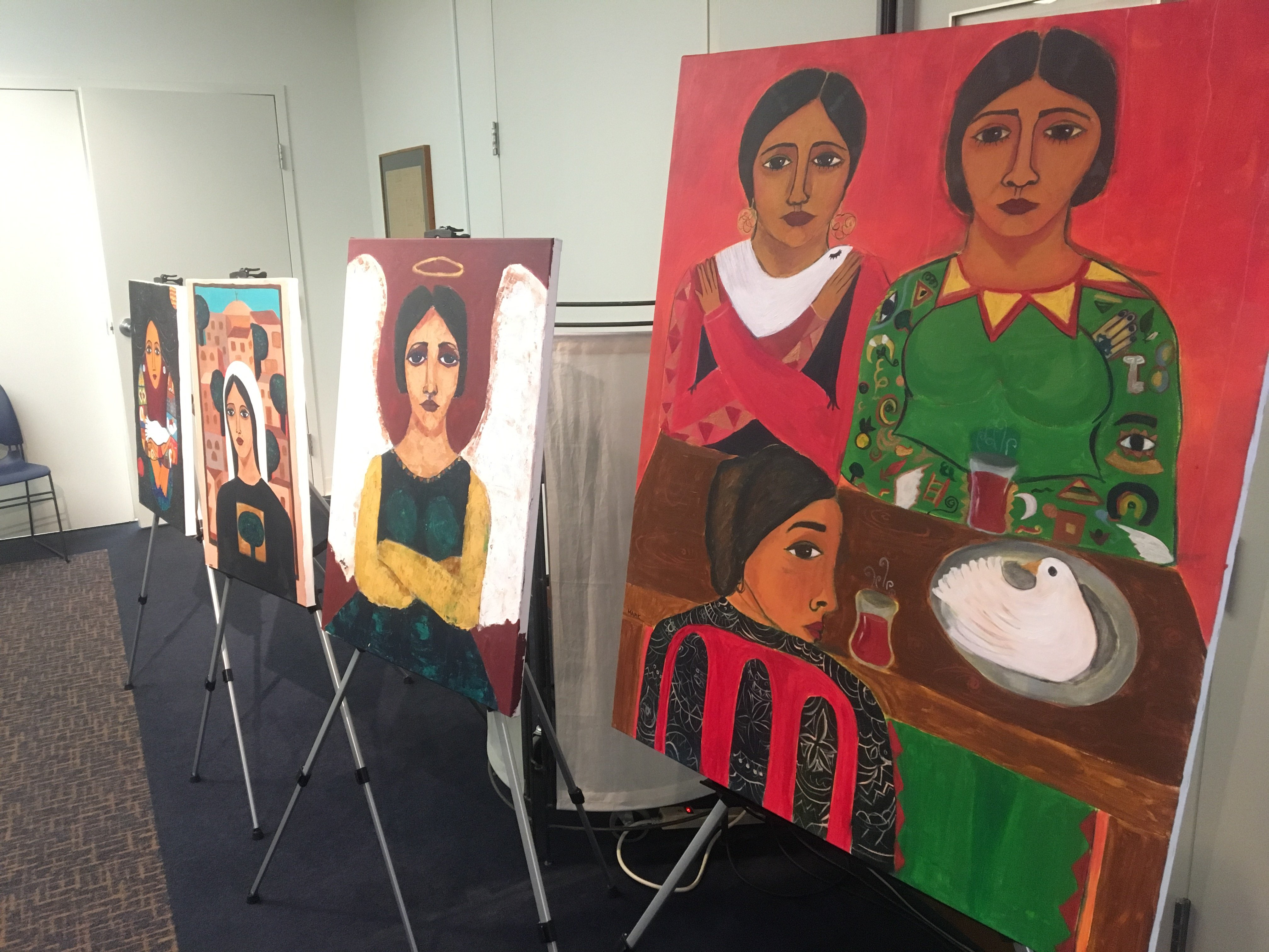 Some of Malak Mattar's work temporarily on display at the Gallery al-Quds in Washington (MEE/Sheren Khalel)