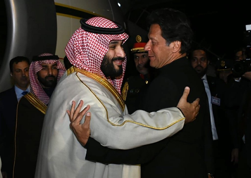 Saudi Crown Prince Mohammed bin Salman and Pakistani Prime Minister Imran Khan greet one another in Islamabad last February (AFP)