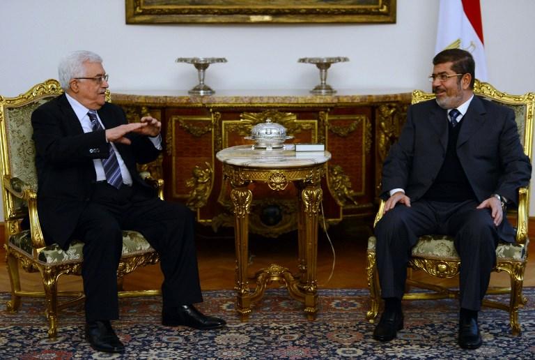 Former Egyptian President Mohamed Morsi meets Palestinian President Mahmoud Abbas in Cairo on 9 January 2013 (AFP)