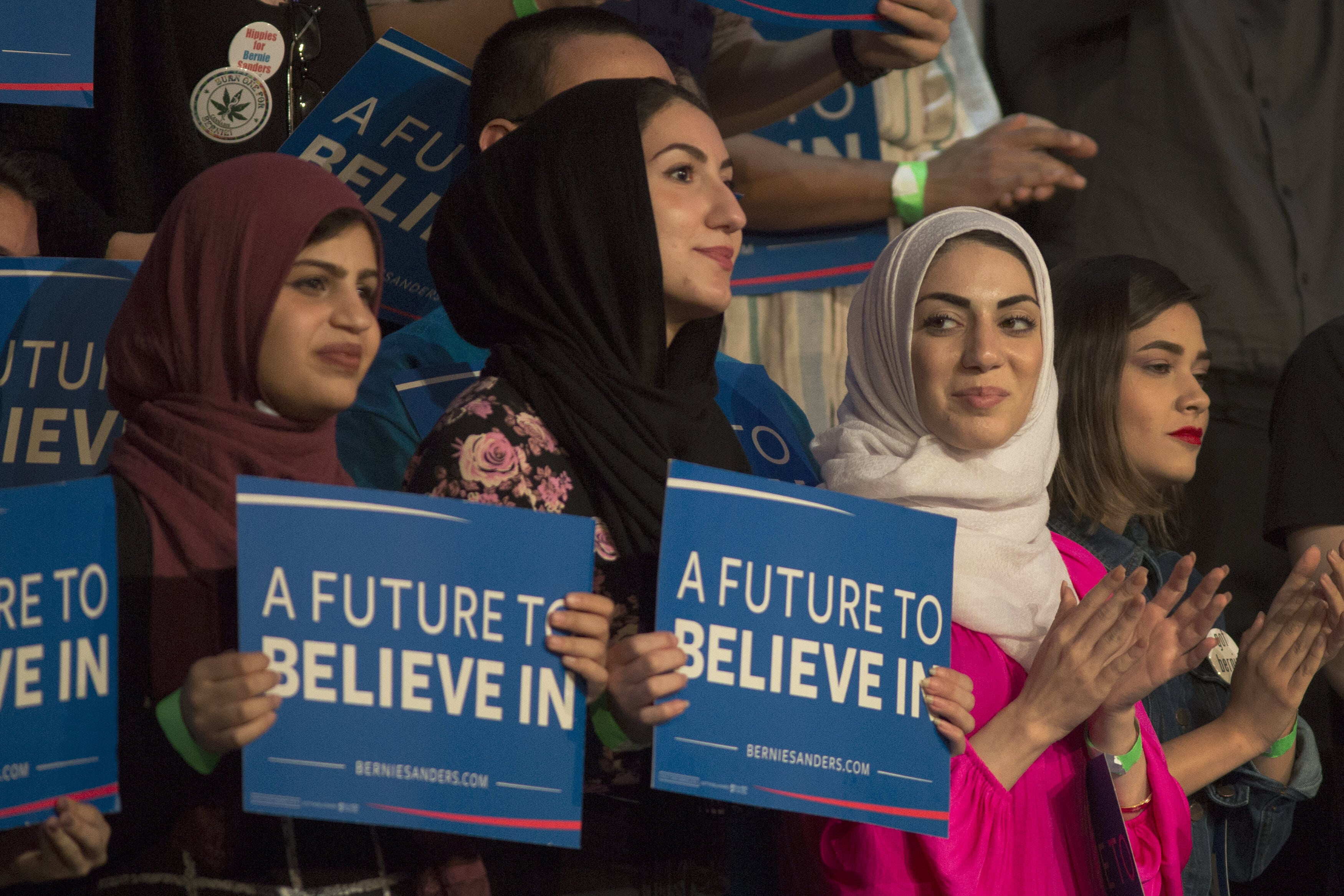 Muslim woman support Democratic presidential candidate Bernie Sanders at a campaign rally in California