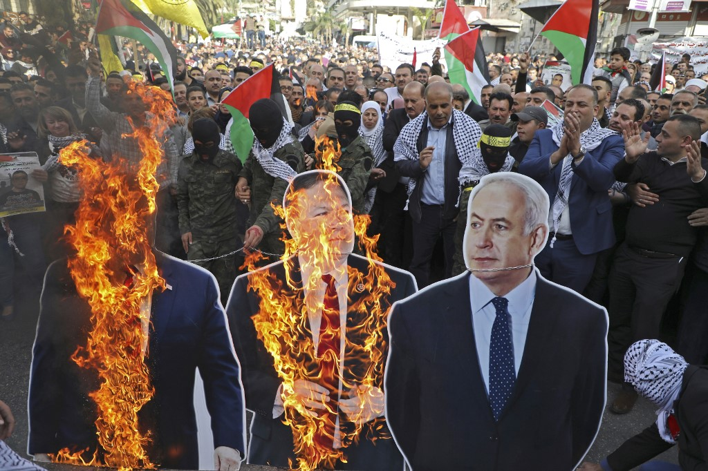 Palestinian protesters burn cardboard cutouts of Trump, US Secretary of State Mike Pompeo and Israeli Prime Minister Benjamin Netanyahu in Nablus in November (AFP)