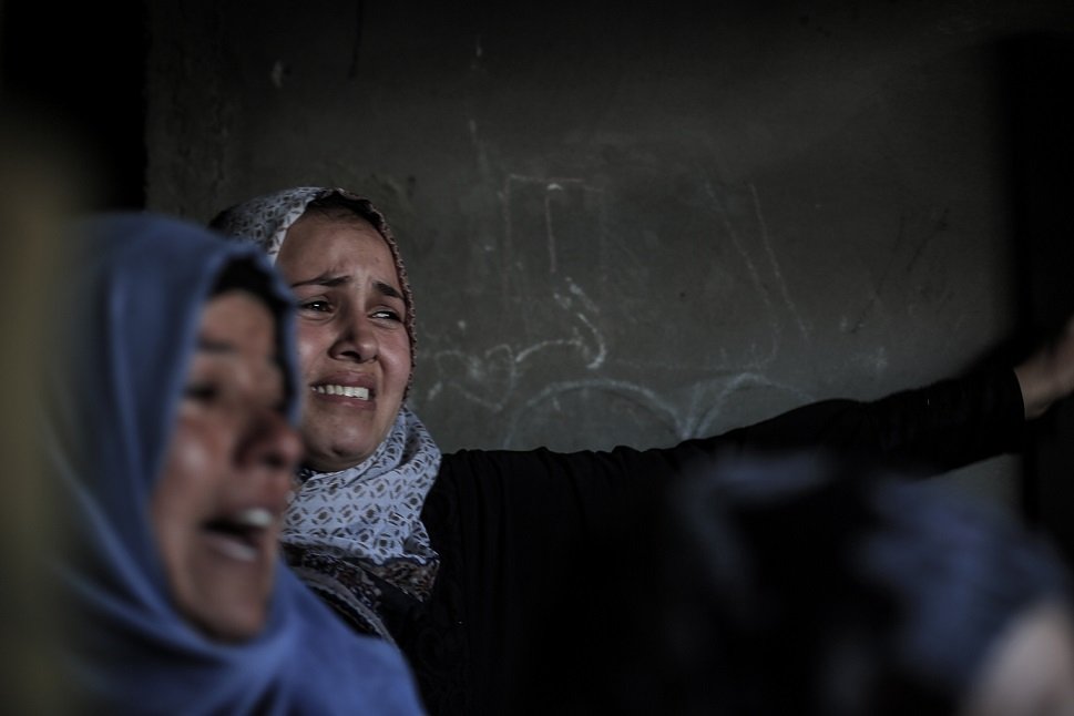 Relatives and friends mourn with Hala al-Najjar at her home (MEE/Sanad Abu Latifa)