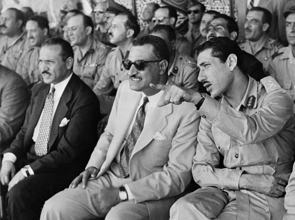 Former Egyptian President Gamal Abdel Nasser sits between the country's local affairs minister and army chief in 1956 (AFP)