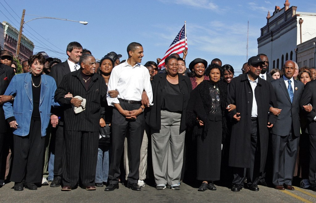 Obama poses for the media while marching in Selma, Alabama, in 2007 (AFP)