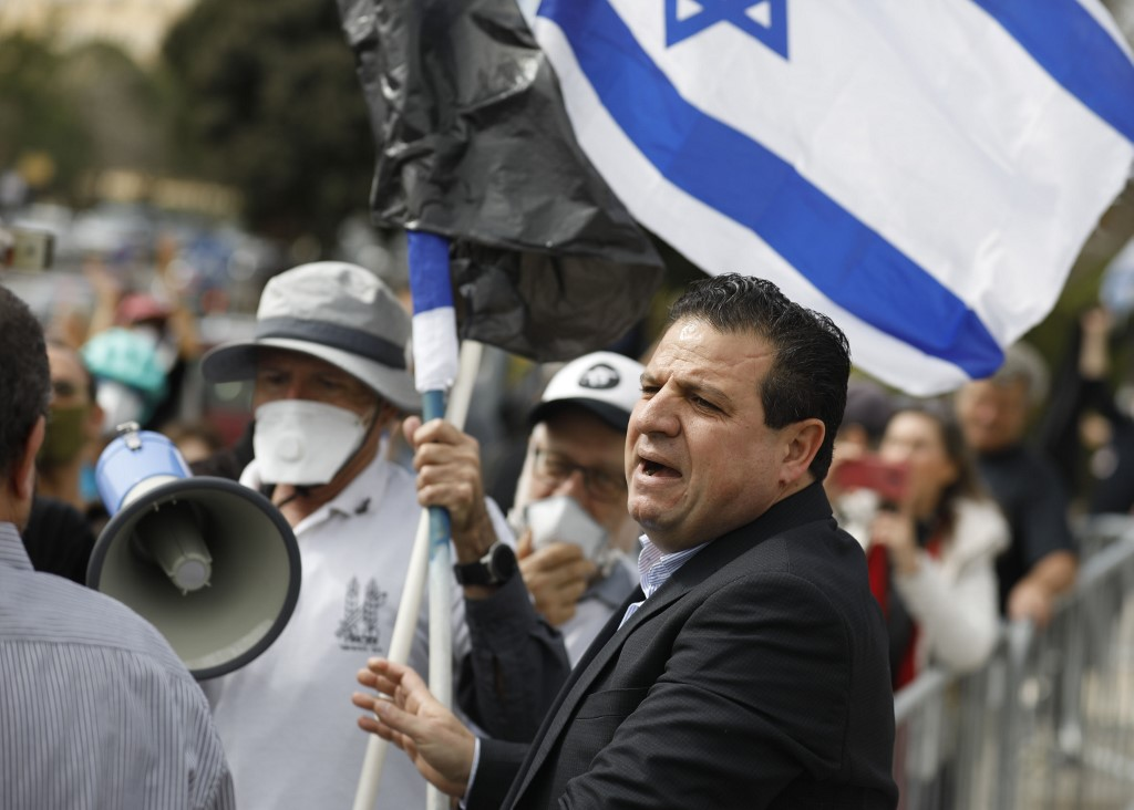 Joint List leader Ayman Odeh attends a protest outside the Knesset in Jerusalem on 23 March (AFP)