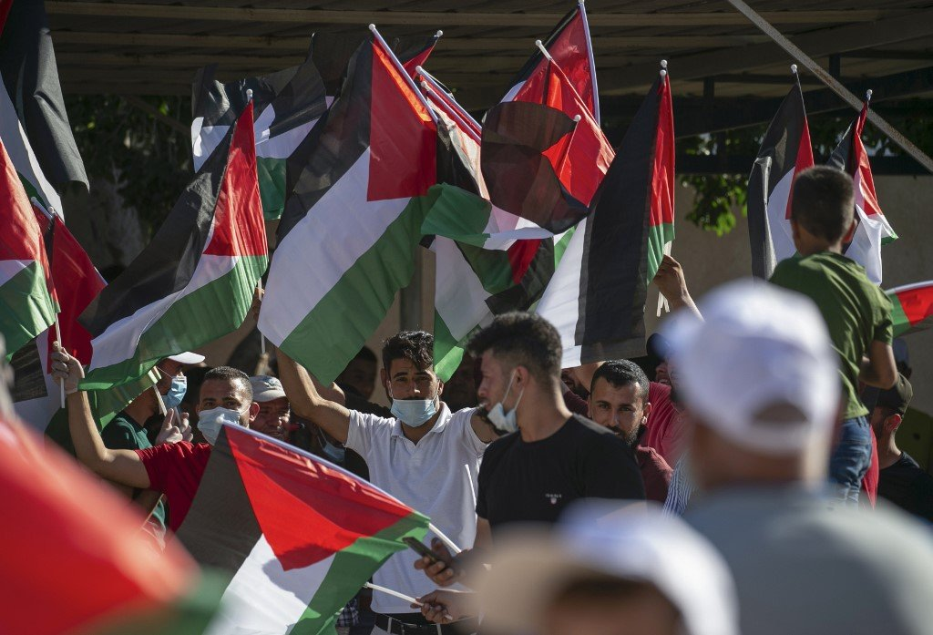Palestinians protest against Israeli annexation plans in the Jordan Valley on 27 June (AFP)