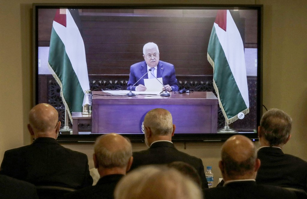 Representatives of Palestinian factions gather in Beirut on 3 September for a video conference with President Mahmoud Abbas and other representatives in Ramallah (AFP)