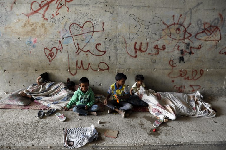 Palestinian children play under a bridge near the Khan al-Ahmar Bedouin village slated for demolition (AFP)