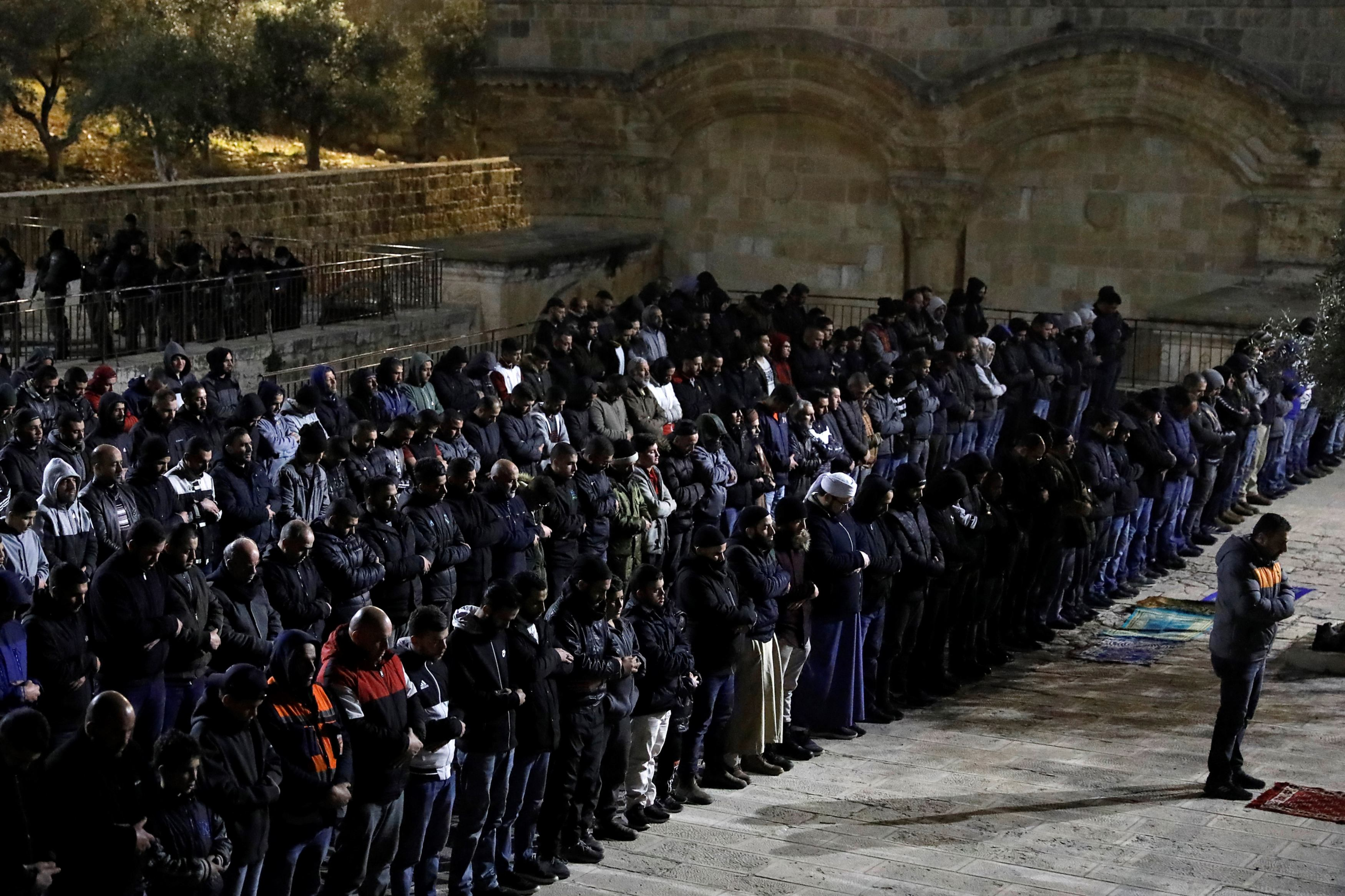 Palestinians pray near al-Rahmeh Gate in the Al-Aqsa mosque compound in Jerusalem on 20 February 2019 (AFP)