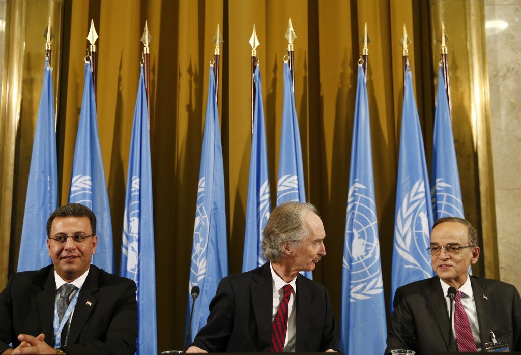 The UN special envoy to Syria, Geir Pedersen, centre; Syrian MP Ahmad al-Kuzbari, left; and opposition representative Hadi al-Bahra attend the committee opening in Geneva on 30 October (AFP)