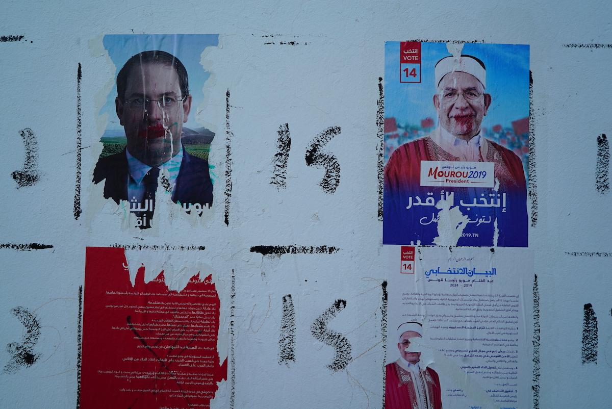 Tunisians vote for new parliament at tough economic moment