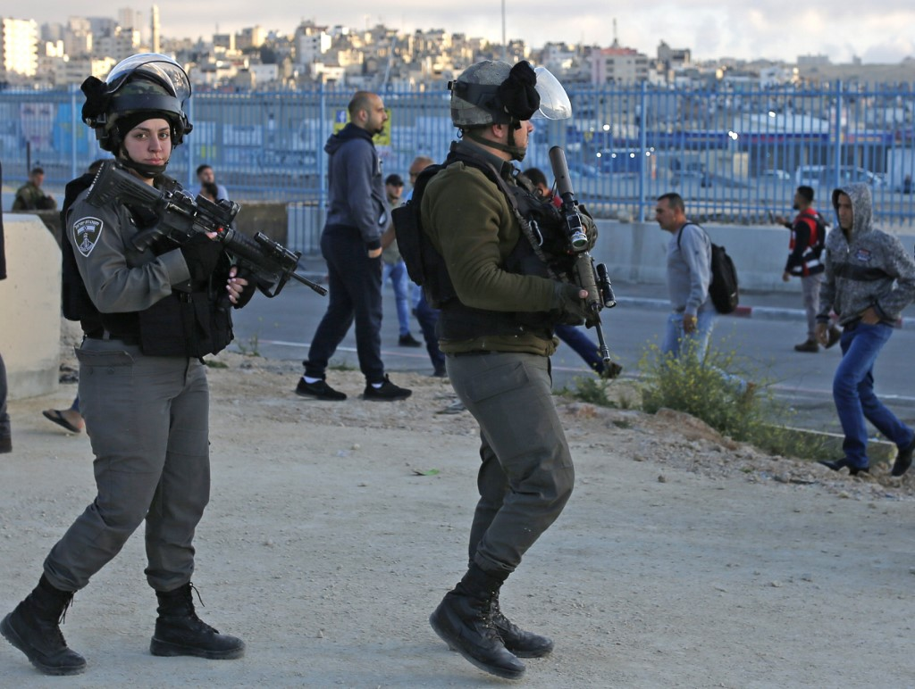 Israeli guards patrol the Qalandia checkpoint in the occupied West Bank on 10 May (AFP)
