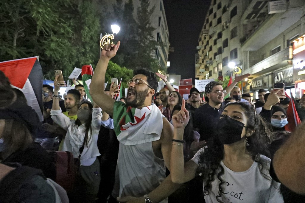 Palestinians protest in the occupied West Bank city of Ramallah on 9 May 2021 (AFP)
