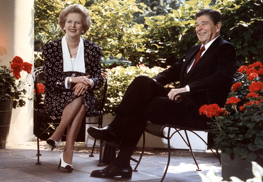 Former US President Ronald Reagan and former British Prime Minister Margaret Thatcher are pictured in Washington in 1987 (AFP)