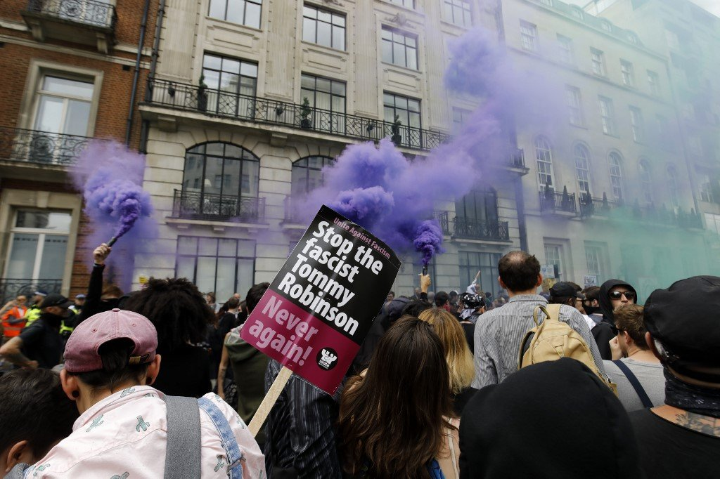 Protesters demonstrate against far-right figure Tommy Robinson in London in August 2019 (AFP)