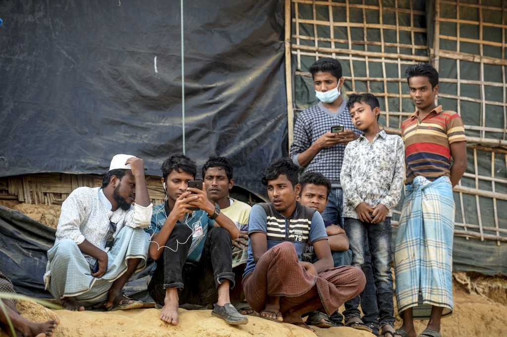 Rohingya refugees are pictured at a camp in southern Bangladesh on 11 December (AFP)