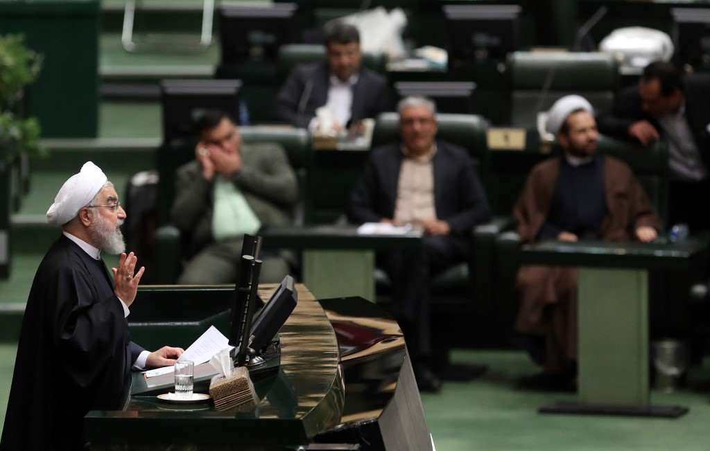 Iranian President Hassan Rouhani speaks to parliament in Tehran on 8 December (AFP)
