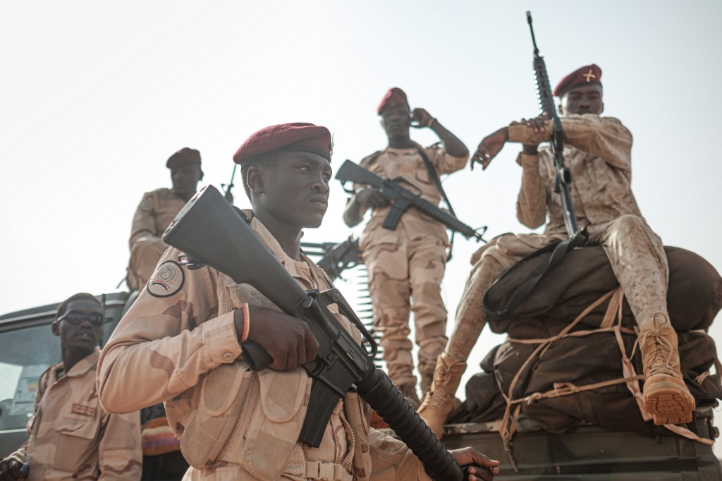 Members of the Rapid Support Forces (RSF) paramilitaries secure the place for a rally for supporters of Sudan's ruling Transitional Military Council (TMC) in the village of Abraq, about 60 kilometers northwest of Khartoum, on June 22, 2019.