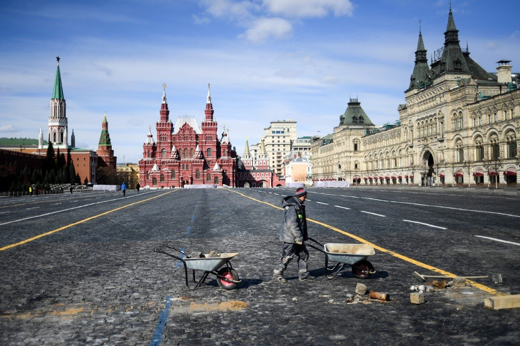 A man works in the deserted Red Square in Moscow on 1 April (AFP)